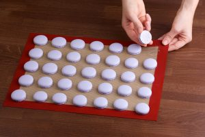 Removing macaroon with a silicone mat after baking